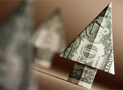 Dollar bill folded into shape of arrow