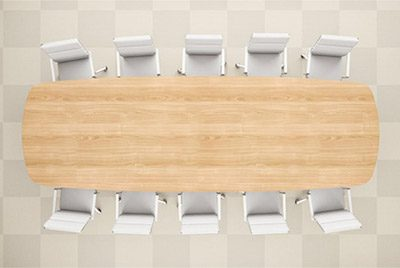 Conference table with empty chairs